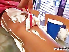 Asian chick shaving her petite legs