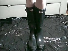 rubber apron and black shiny rubber boots with puppy play