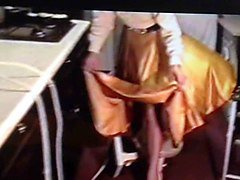 wife in gold satin skirt dominated by husband 2