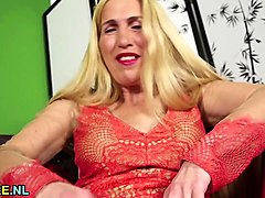 hairy blonde mature masturbating in a chair